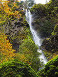 Waterfall at Oregon's Starvation Creek State Park in autumn.