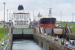 NCL Cruise ship Norwegian Sun and Chinese freighter in Gatun Locks of Panama Canal.