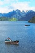 Ships on coast of Chile at Puerto Chacabuco in Patagonia region.