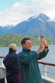 Man making selfie from cruise ship off Chilean coast near Patagonian town of Puerto Chacabuco.