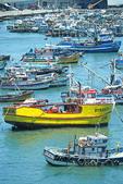 Fishing boats in harbor at port of San Antonio, Chile.