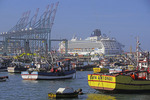 Port of San Antonio, Chile, with fishing boats and cruise ship Norwegian Sun.