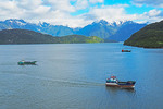 Ships on Chilean coast at Puerto Chacabuco in Patagonia region.