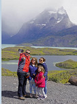 Happy family posing for a selfie photo at Torres del Paine National Park in Patagonia region of Chile.