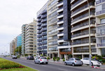 Modern blocks of ocean view apartments and condos along the Rambla in Montevideo, Uruguay.