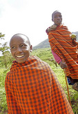 Maasai boys playing ball in countryside near Ngorongoro Crater in Tanzania.