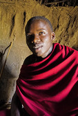 Young Maasai man in his family hut in village near Ngorongoro Crater, Tanzania.