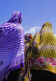 Colorful hijabs worn by three Muslim women in Zanzibar's Stone Town.