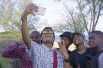Young men making a group selfie photo with a cell phone camera in Zanzibar.