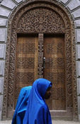 Newly carved door of traditional design on commercial building in Zanzibar's Stone Town.