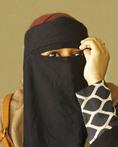 Fashionably dressed married Muslim woman wearing niqab in Zanzibar's Stone Town.