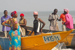 Fishing families from village gathering on fishing boats on shore of Lake Edward in Uganda's Queen Elizabeth National Park.