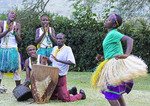 Traditional Ankole Kingdom song and dance troop entertaining at Nshenyi Cultural Center in Kitwe, Uganda.