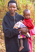 Young rural Ugandan mother with female child.