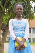 Young teen girl dressed for a Sunday wedding in Kampala, Uganda.