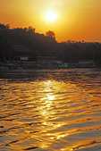 Sunset on the Victoria Nile river at Murchison Falls National Park in Uganda.