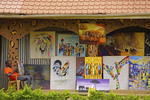 Paintings for sale at shop in the 3D Art & Cultural Village in Kampala.