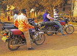 Unemployed young men loitering on their boda-boda motorcycles in Kampala.