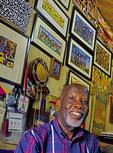 Portrait of prominent artist Nuwa Wamala Nnyanzi in his art studio gallery at 3D Art & Cultural Village in Kampala, Uganda.