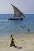 Dhow sailing just off the beach of Stone Town in Zanzibar.