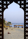 Stone Town beach seen through Serena Hotel window frame on island of Zanzibar.