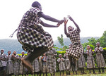 Orphans from Bwindi School jumping in dance performance for guests of Silverback Hotel.