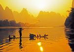 Guangxi, China:  Fisherman on bamboo raft tossing net on Li River near Xingping