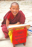 Novice monk during religious study at Drepung Monastery near Lhasa, Tibet.