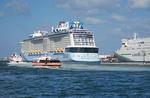 Royal Caribbean mega cruise ship Quantum of the Seas and Camellia Lines ship in port of Fukuoka, Japan.