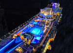 Royal Caribbean mega-cruise ship Quantum of the Seas, at night in East China Sea, from North Sea capsule.