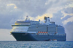 Holland America's Vista-class cruise ship m/s Westerdam anchored at Ishigaki Island, Japan.