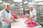 Cruise ship galley meat cutters on Holland America's m/s Westerdam.