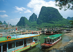 Tourist cruise boats on Li River at Yangshuo after daily cruise.