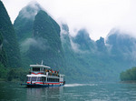 Tourist cruise boat on Li River from Guilin to Yanshuo, Guangxi, China.
