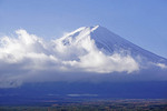 Mount Fuji emerging from clouds in early morning viewed from Kawaguchiko, Japan.