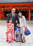 Family with brother and sister dressed up in traditional clothing for a shichi-go-san (seven-five-three) festival celebration at Sumiyoshi Shinto Shrine in Fukuoka, Japan.