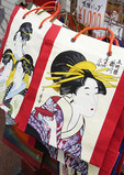 Geishas depicted on shopping bags in Tokyo souvenir shop at Senso-ji Temple in Asakusa.