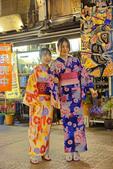 Young women in kimonos at Sensoji Temple shopping street in Tokyo
