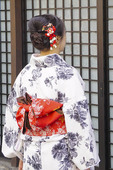 Japanese woman in formal kimono at traditional house in Kyoto.