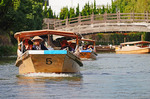 Cruising the scenic canals with 16 bridges and moat of the Matsue Castle near Sakaiminato in Japan.