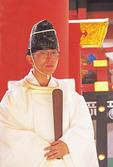 Shinto priest at Kasuga Taisha Grand Shrine in Nara, Japan.