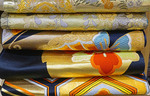 Maru or Fukuro Obi belts for traditional Japanese kimonos, decorated with artistic designs, on sale in Tokyo department store.