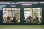 Women passengers in Kyoto subway train car.