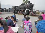 Children sketching steam locomotive in Nanjing