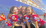 High school girls from a marching band meet the Westerdam cruise ship at Port of Manila, Philippines.