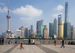 Skyline of Pudong across Huangpu River from Bund Promenade in Shanghai.