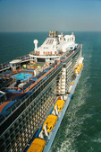 Royal Caribbean mega cruise ship Quantum of the Seas cruising in the East China Sea viewed from North Star capsule.