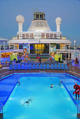 Swimmer in midship pool of Quantum of the Seas mega cruise ship of Royal Cribbean Lines.