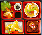 Traditional wooden Japanese Bento box with lunch foods.
