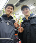 Young Japanese men on subway from Osaka touring Tokyo.